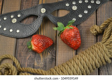 BDSM mask, strawberry and bondage rope