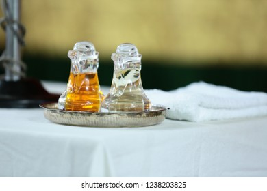Be anointed by these that is used during a holy baptism ceremony