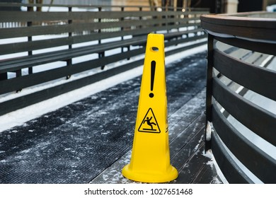 Be aware of slippery road. Slippery yellow surface sign. Wet floor sign. Icing concept. Selective focus. Slippery slope. Watch your step, please