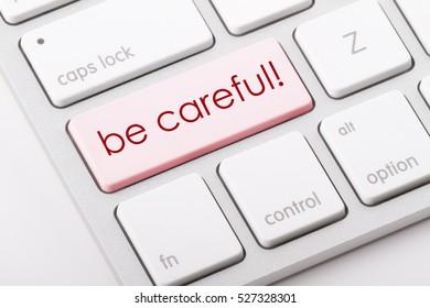 Be careful word written on computer keyboard.