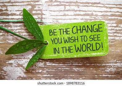 Be the change you wish to see in the world! - Text on natural label - Shutterstock ID 1898783116
