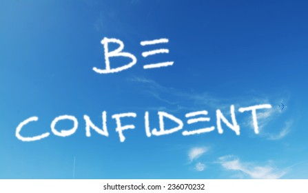 """""""be confident"""" written in a blue sky with fireworks"""