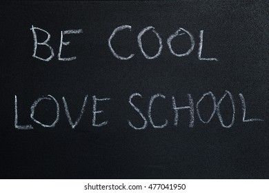 be cool, love school sentence written on a chalkboard in kids writing. symbolizing love for knowledge