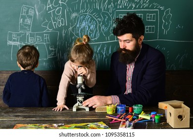 Be cool and you will be able to attract and retain lot more students. Students usually get excited about the material. Attentive schoolkid is doing his math homework in classroom at school.