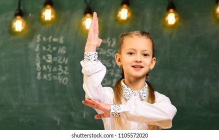 Be cool and you will be able to attract and retain lot more students. Students usually get excited about the material. Attentive schoolkid is doing his math homework in classroom at school