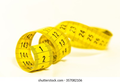 be the first, still life with a yellow tape measure with the number one in the foreground, symbol of success and goal