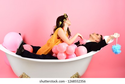 Be gentle with your hair. Couple in bath tub. Bathing hygiene habits. Couple of mime man and sexy woman enjoy bathing. Bubble bath day. Beauty routine and personal hygiene. Hair grooming routine.