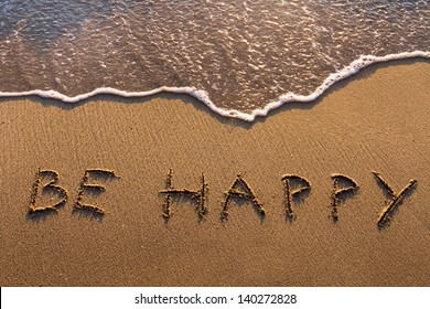 be happy, words written on the beach