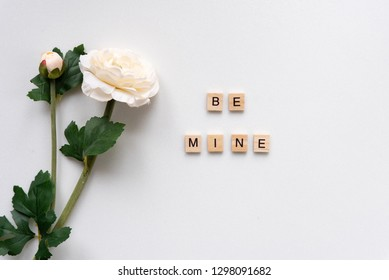 Be mine words on white marble background