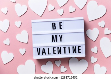 Be My Valentine lightbox message with white hearts on a pink background