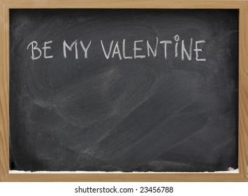 be my Valentine phrase handwritten with white chalk on blackboard, dust and eraser smudges