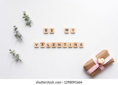 Be My Valentine words on white marble background