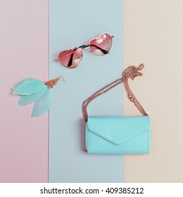 Be Pastel Trend. Fashionable Women's Accessories. Earrings, Sunglasses, Clutch. Detail Fashion