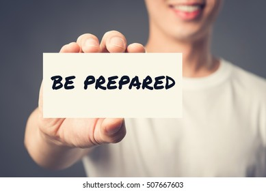 BE PREPARED, message on the card shown by a man, vintage tone effect