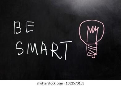 Be smart concept words written on blackboard