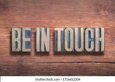 be in touch phrase combined on vintage varnished wooden surface