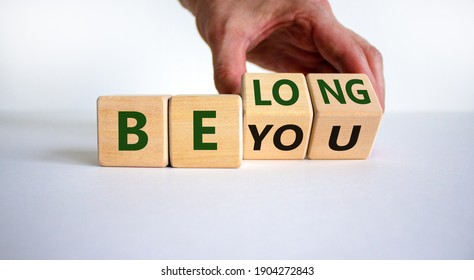 Be you, belong symbol. Businessman hand turns cubes and changes words 'be you' to 'belong'. Beautiful white background. Business, belonging and be you, belong concept. Copy space.