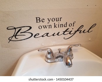 be your own kind of beautiful sign and bathroom sink