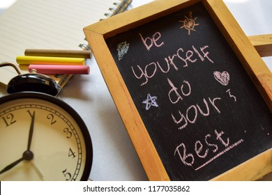be yourself do your best on phrase colorful handwritten on chalkboard, alarm clock with motivation and education concepts.