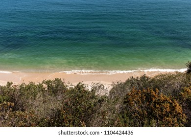 Beach from above through trees, Arrabida, Portugal