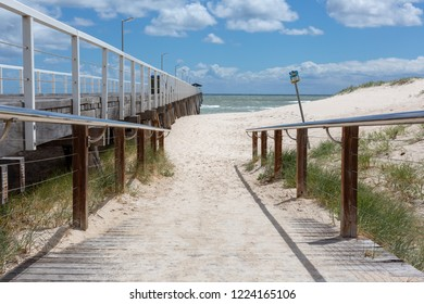 The beach access ramp along side of the grange jetty with a blue sky and white fluffy clouds at Grange South Australia on 7th November 2018