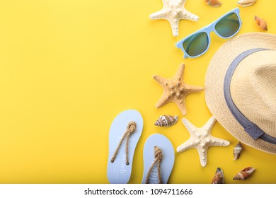 beach accessoires at yellow background