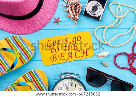 d64ed9dca93 Beach accessories on blue background. Essential women things for sea around  message. Pink dreams