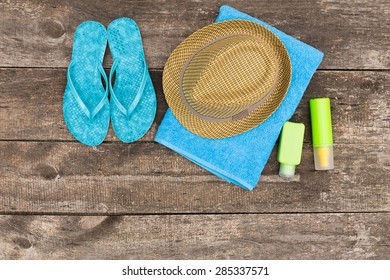Beach accessories on old wooden board
