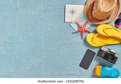 Beach accessories on a beach towel