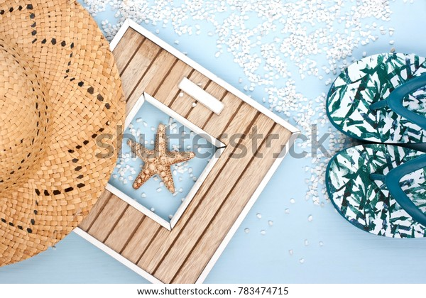 Beach accessories on wooden board. Vacation and travel items, top view