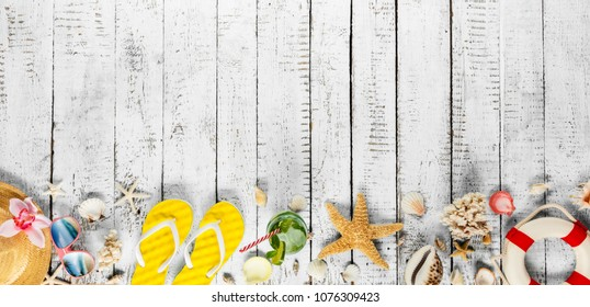 Beach accessories placed on white wooden planks, top view. Summer holidays concept, free space for text. Very high resolution image