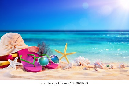 Beach Accessories With Seashells On Seashore - Summer Holidays