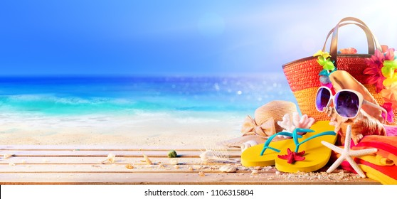 Beach Accessories With Seashells On Wooden Deck In Sunny Seashore - Summer Holidays