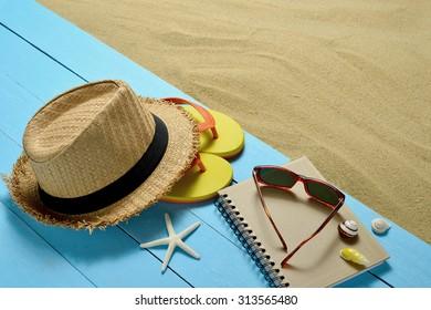 Beach accessories with starfish and seashells on sandy beach