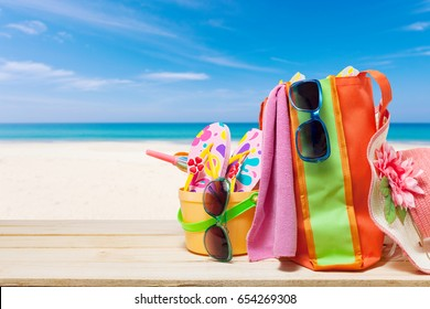Beach accessory,hat,sunglasses,shoes,umbrella on wooden, concept summer holiday background and summer sale