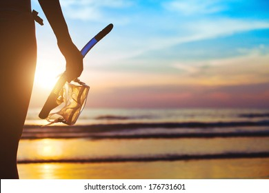 beach adventure, silhouette of hand with equipment for snorkeling