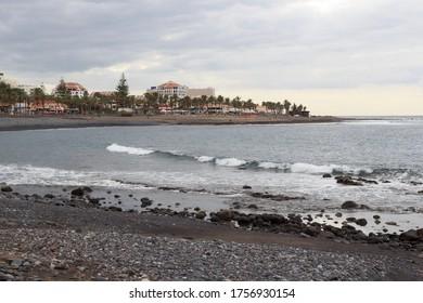 Beach and Atlantic Ocean panorama in holiday resort Playa de las Americas on Canary Island Tenerife, Spain