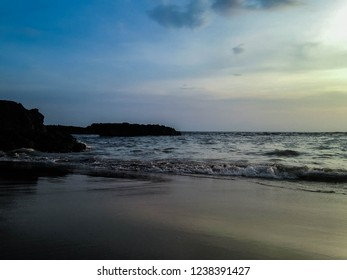 Beach Atmosphere With The Sea Rocks In The Evening At Batu Bolong Beach, Canggu Village, Badung, Bali, Indonesia