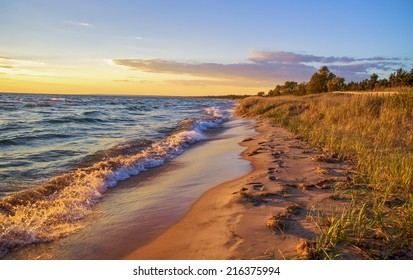 Beach Background. Beautiful sandy beach stretches to the blue sky horizon.