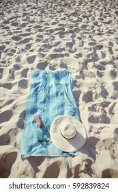 beach background with hat, towel and glasses