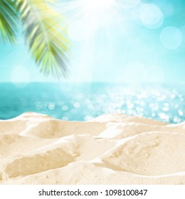 Beach background with sand and palm decoration. Summer photo of free space for your decoration.