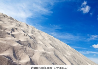 Beach background with sand, and sky on a sunny day