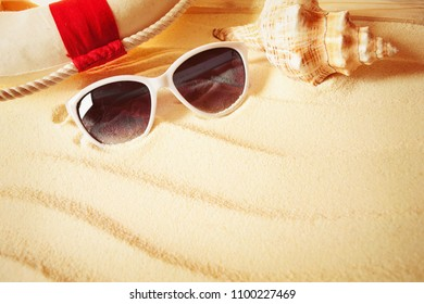 Beach background. Beach sand with sunglasses and shells