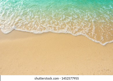 Beach Background with Sandy beautiful white foamy and wave from the sea,beach top view.