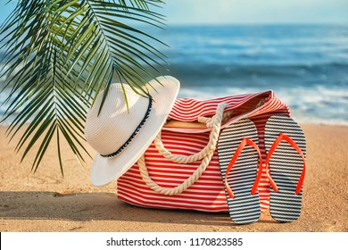Beach bag and accessories on sea coast at tropical resort