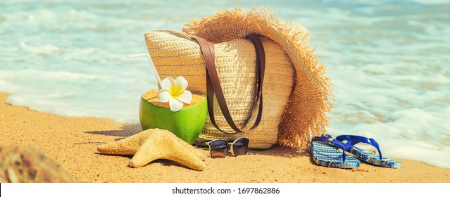 Beach bag and coconut at sea. Selective focus. Travel.