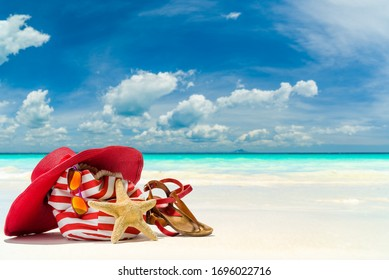 Beach bag hat and starfish at the tropical beach