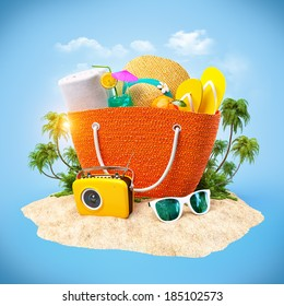 Beach bag with hat, towel and other on a sand. Travel Background
