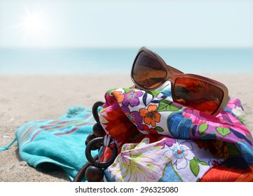 Beach bag with sunglasses on a background of sea
