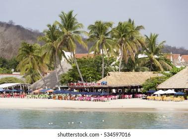 The beach of Bahia de Santa Cruz resort town (Huatulco, Mexico).